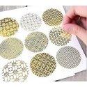 27 Etiquetas adhesivas redondas, transparentes con motivos dorados.