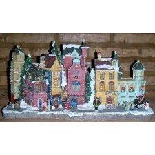 Grupo de casas de resina con figuras y luz leden varios tonos