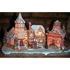 Grupo de casas y campanario, de resina, con figuras y luz led en varios tonos. AGOTADO