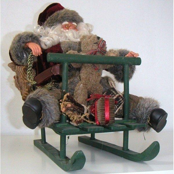 Papa noel musical con trineo de madera, osito y saco de regalos 35 cms